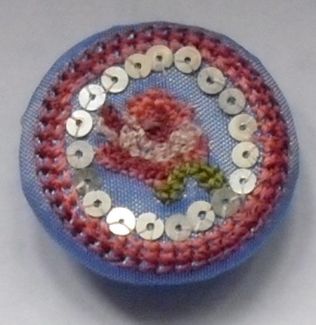 Blue taffeta button with pink rosebud